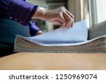 the hand of a woman holds... | Shutterstock . vector #1250969074