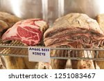 dry aged ribeye steak on... | Shutterstock . vector #1251083467