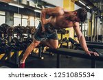 sporty man training at the gym   Shutterstock . vector #1251085534
