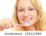 a young woman brushing teeth ... | Shutterstock . vector #125111984