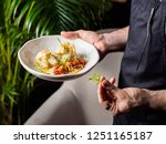 cropped view of waiter serving... | Shutterstock . vector #1251165187