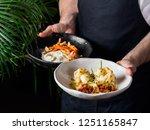 waiter serving roasted... | Shutterstock . vector #1251165847