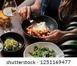 woman eating salad with burrata ... | Shutterstock . vector #1251169477
