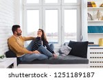 loving couple sitting together... | Shutterstock . vector #1251189187