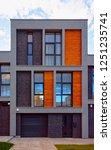 facade of modern residential... | Shutterstock . vector #1251235741