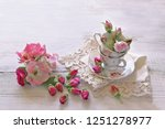 roses tea with cups on lace  | Shutterstock . vector #1251278977