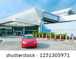 red taxi cab by airport... | Shutterstock . vector #1251305971