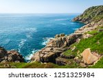 rocky coast and turquoise ocean ... | Shutterstock . vector #1251325984