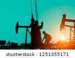 the oil workers at work | Shutterstock . vector #1251355171
