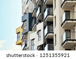 modern apartment buildings on a ... | Shutterstock . vector #1251355921