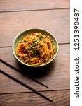schezwan noodles or vegetable... | Shutterstock . vector #1251390487
