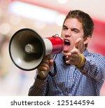 Young Man Shouting On Megaphon...