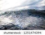 winter sailing. cold blue sea... | Shutterstock . vector #1251474394