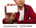 Construction worker holding a blank business card, business introduction concept. - stock photo