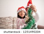 asian little girl with mother... | Shutterstock . vector #1251490204