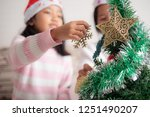asian little girl with mother... | Shutterstock . vector #1251490207