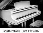 White Piano With Table And...