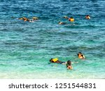 people who play in the sea at... | Shutterstock . vector #1251544831
