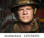 close up of a young firefighter ... | Shutterstock . vector #125156351