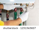 a plumber attaches to a gas... | Shutterstock . vector #1251565837