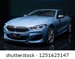 Small photo of Nonthaburi , Thailand - Dec 6, 2018: BMW the 8 Series Coupe blue color in motor expo , black background .