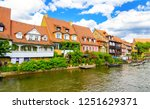 city river houses panorama.... | Shutterstock . vector #1251629371