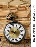 antique watch and books | Shutterstock . vector #125167799
