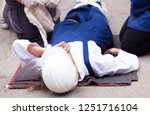 first aid after work accident   Shutterstock . vector #1251716104