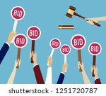 auction concept  hands holding... | Shutterstock . vector #1251720787