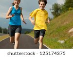 girl and boy running outdoor | Shutterstock . vector #125174375