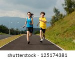 girl and boy running outdoor | Shutterstock . vector #125174381