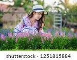 beautiful woman on a flower... | Shutterstock . vector #1251815884