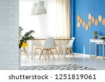bright blue and white dining... | Shutterstock . vector #1251819061