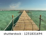 view at the wooden pier in the...   Shutterstock . vector #1251831694