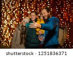 father taking selfie with... | Shutterstock . vector #1251836371