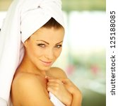 Sexy woman with towel wrapped after taking bath at home - stock photo