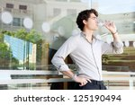 young businessman leaning on an ... | Shutterstock . vector #125190494