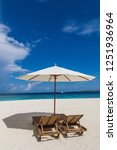 parasol and sunbeds on the... | Shutterstock . vector #1251936964