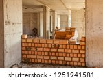 bricklaying of walls in a high... | Shutterstock . vector #1251941581