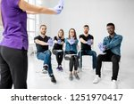 group of young people sitting... | Shutterstock . vector #1251970417