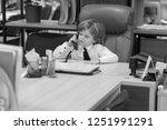 little boy sits in the office...   Shutterstock . vector #1251991291