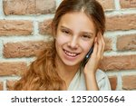 smiling teen girl with long... | Shutterstock . vector #1252005664