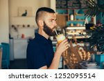 young beard brutal man drinking ... | Shutterstock . vector #1252095514