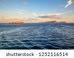 sunrise on the aegean sea with... | Shutterstock . vector #1252116514