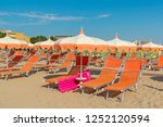 umbrellas and chaise lounges on ... | Shutterstock . vector #1252120594