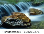 A Pair Of River Rocks With A...