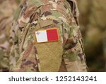 flag of malta on soldiers arm.... | Shutterstock . vector #1252143241