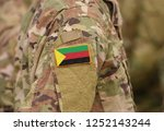 flag of azawad on soldiers arm. ... | Shutterstock . vector #1252143244