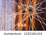 a rusty bicycle hub and spokes... | Shutterstock . vector #1252181101