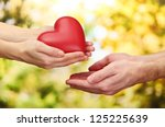 red heart in woman and man... | Shutterstock . vector #125225639